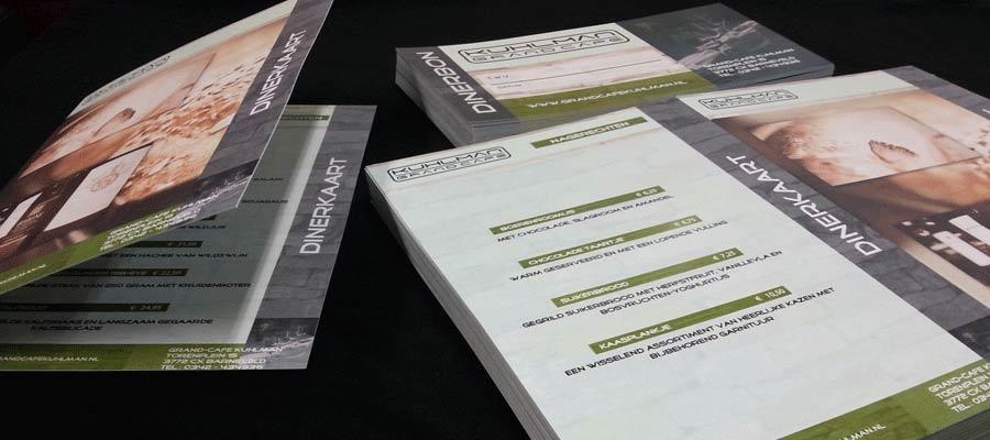 Dubbelzijdige menukaarten met rilrand (vouwrand) en waardenbonnen in Kuhlman huisstijl door van Veldhuizen Reclame.